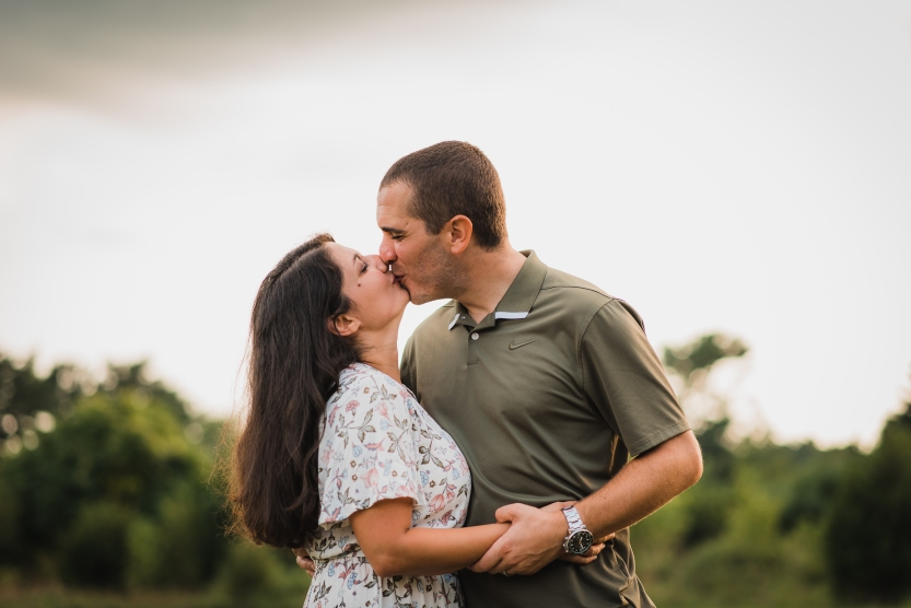 A husband and wife kissing at a photo session in Sewell NJ